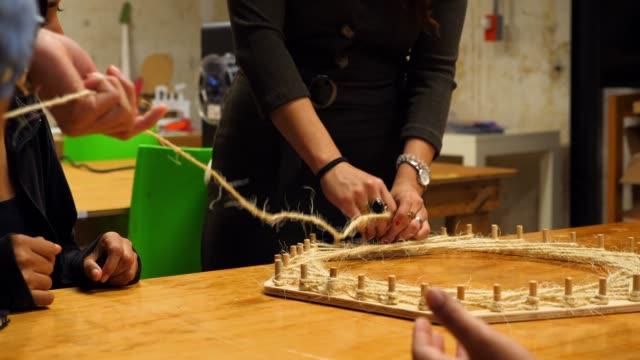 ms engineers working on prototype in workshop - プロトタイプ点の映像素材/bロール