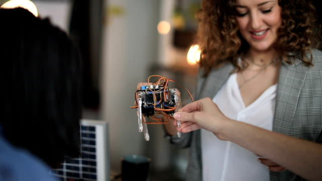 engineers working on solar robot - gente comune video stock e b–roll