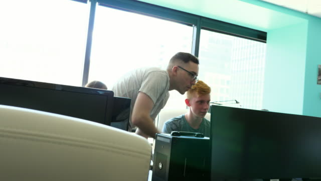 ms engineers working together in computer lab - colleague help stock videos & royalty-free footage