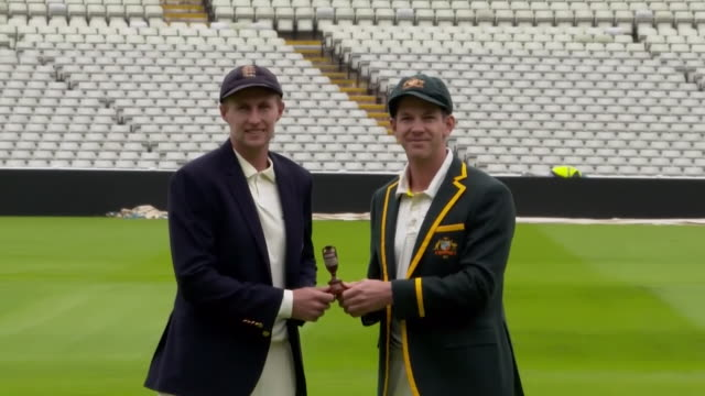 england and australia cricket captains, joe root and tim paine, pose with ashes trophy at edgbaston before the start of the competition - ashes test stock videos & royalty-free footage