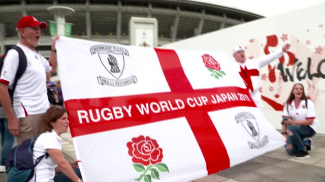 england and new zealand fans before and after their rugby world cup semi-final in yokohama, japan - 準決勝点の映像素材/bロール