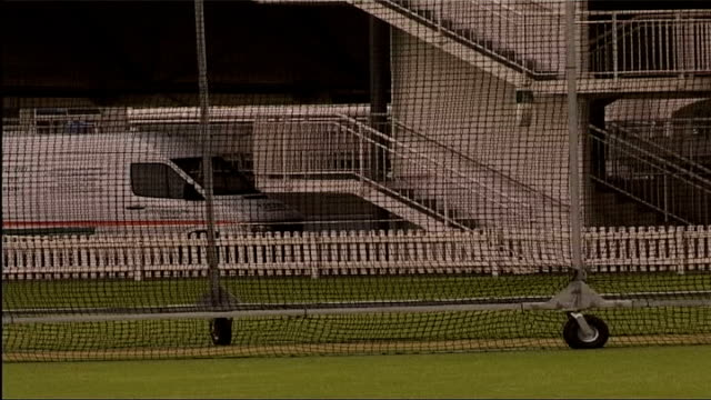 england and pakistan train ahead of first test itn london lords ext nasser hussein wearing helmet in nets / andy caddick practicing batting and... - hair length stock videos and b-roll footage