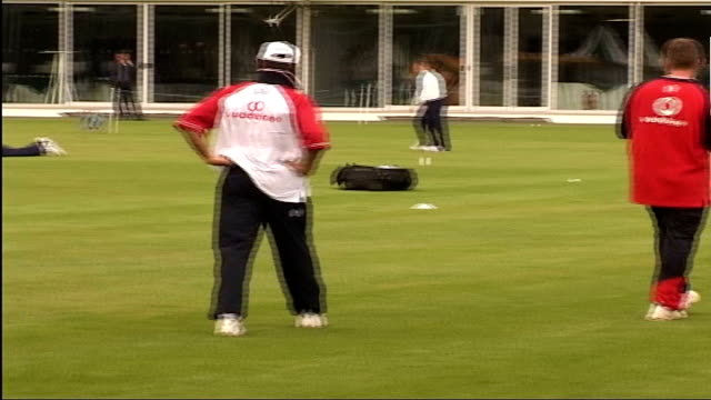 England and Pakistan train ahead of first test ITN London Lords EXT England Cricket Team training on pitch / Nasser Hussein running towards / English...