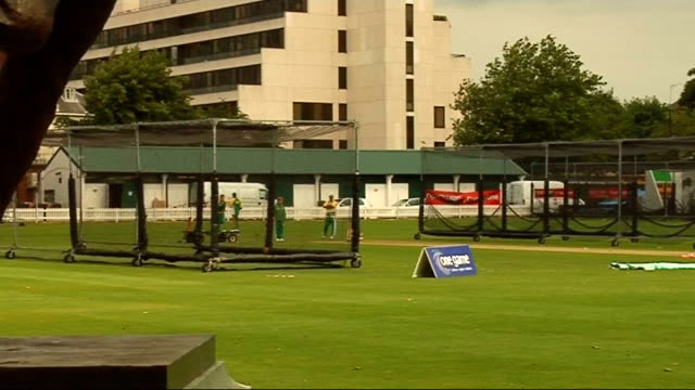 England and South Africa training Bowler statue South African cricketers practicing in nets Groundsmen preparing pitch Pavilion and pitch South...