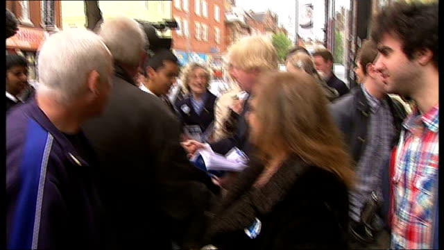 england and wales local elections 2012: labour make gains; england: london: ext various of boris johnson greeting people on the street alexandra... - man and machine stock videos & royalty-free footage