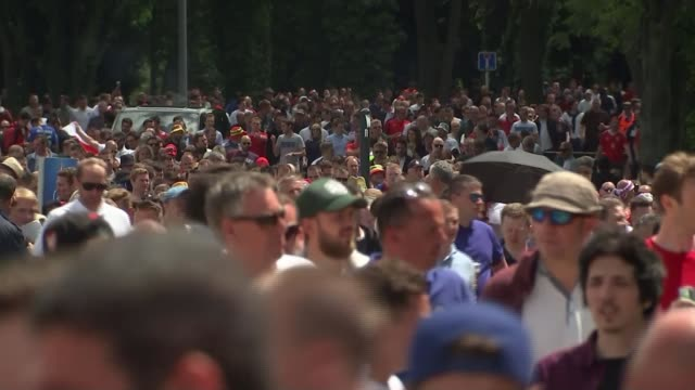 england beat wales france lens ext large crowd of england and wales fans along towards stadium close shot of fan wearing 'england' sunglasses wales... - lens pas de calais stock videos & royalty-free footage