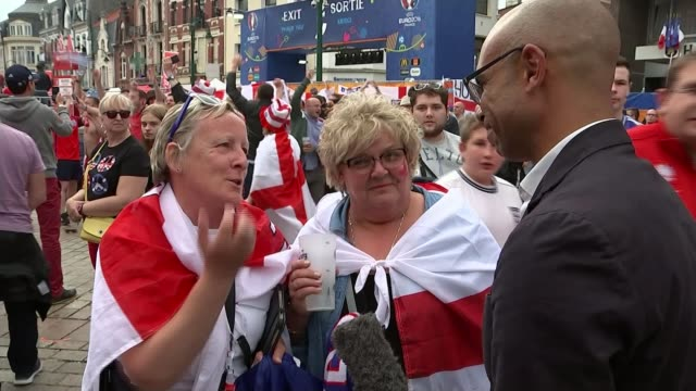 england beat wales lens fanzone reporter to camera/ england fan celebrating in fan zone area/ vox pops/ wales supporters leaving stadium at end of... - lens pas de calais stock videos & royalty-free footage