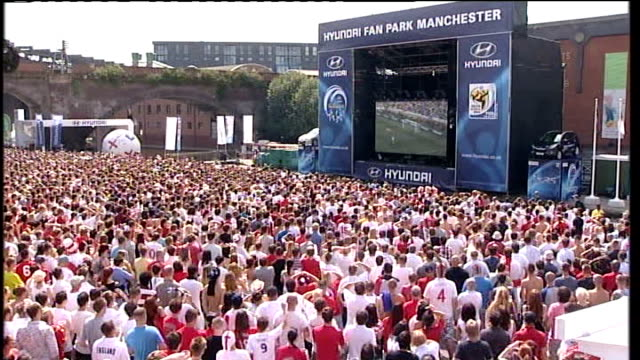 england beaten by germany; manchester: crowd watching england v germany match on giant screen - イングランド点の映像素材/bロール
