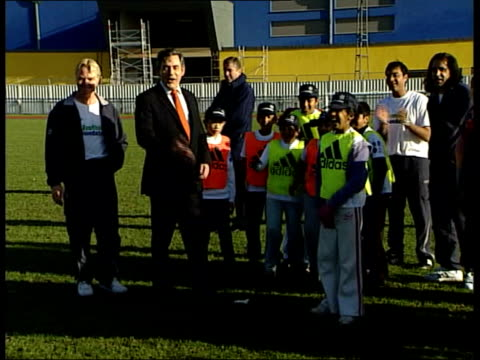 england bid to host world cup 2018; england: london: mile end stadium: ext gordon brown mp applauding as children on football foundation programme... - the world's end stock videos & royalty-free footage