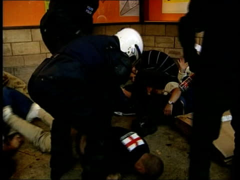 england bid to host world cup 2018; france: french police beating england football fans bv french police with line of seated arrested england fans... - bid stock videos & royalty-free footage