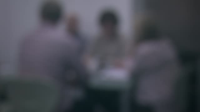 england blocks use of hepatitis c drug; int reconstruction of meeting between nice and nhs england - blurred shots of people at table and hands... - rnaウイルス点の映像素材/bロール