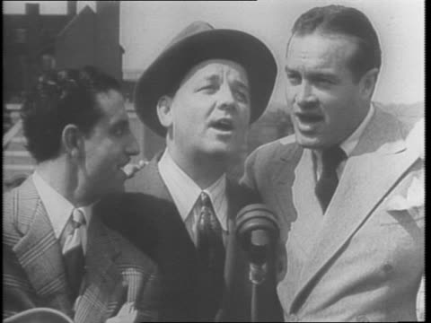 england / bob hope walks around london and visits his 99 year old grandfather / aerial shot of london / hope getting off train shakes hands with us... - 1943年点の映像素材/bロール