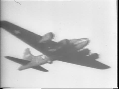 England / Boeing B17 Flying Fortress 'Memphis Belle' bombers in a firefight with Nazi Fighter Planes / bombers returning to England / pilot Captain...