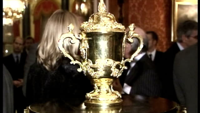 England bring home the Webb Ellis Cup after winning the 2003 Rugby World Cup Shows interior shots the Web Ellis cup on plinth players talking with...
