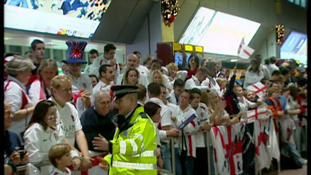 england bring home the webb ellis cup after winning the 2003 rugby world cup. shows interior shots england fans cheering in heathrow terminal... - cup stock videos & royalty-free footage