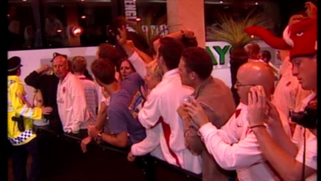 england bring home the webb ellis cup after winning the 2003 rugby world cup. shows exterior shots england fans cheering clive woodward at the team... - cup stock videos & royalty-free footage