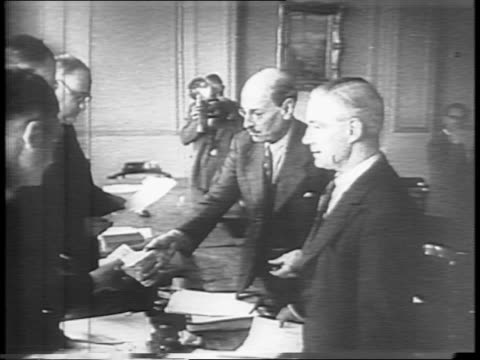 stockvideo's en b-roll-footage met england / british house of parliament palace of westminster exterior / leader of the labor party clement r attlee seated and speaking to the camera /... - labor partij