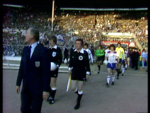 England captain Kevin Keegan and Argentina captain Daniel Passarella lead teams out for friendly international England vs Argentina Wembley Stadium...