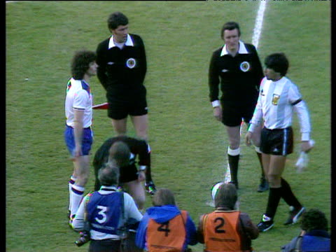 England captain Kevin Keegan and Argentina captain Daniel Passarella shake hands and exchange pennants before start of international friendly England...