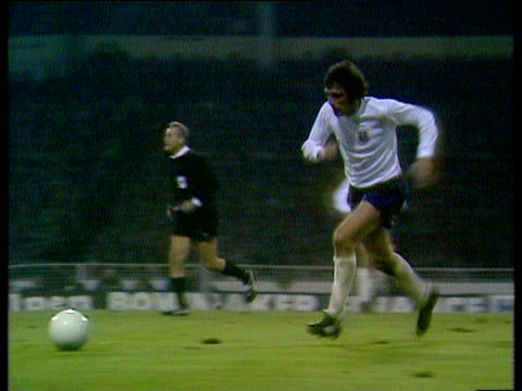 england centre half norman hunter receives pass from captain martin peters and shoots at goal poland goalkeeper jan tomaszewski dives to his left and... - world cup qualifying round stock videos and b-roll footage