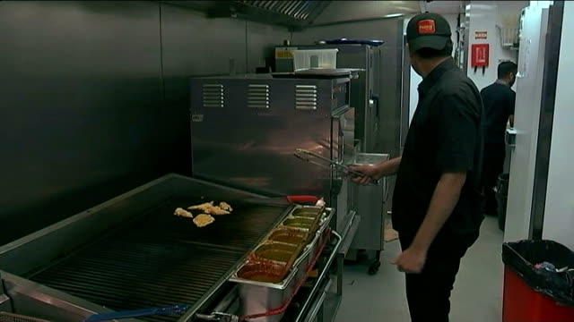 nhs england chief executive unveils fiveyear plan west midlands birmingham int close shot chicken being cooked in fast food restaurant kitchen chef... - take away food stock videos & royalty-free footage