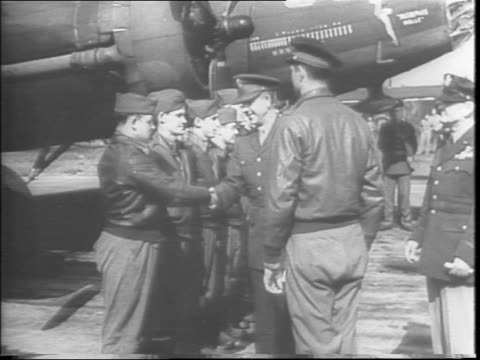 England / crew lined up in front of their Boeing B17 Flying Fortress 'Memphis Belle' bomber shaking hands with Commanding Lieutenant General Jacob L...