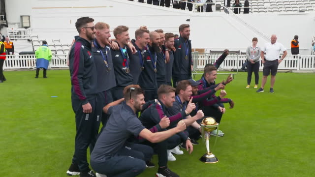 england cricket team pose with world cup trophy at the oval the day after winning the world cup final - world sports championship stock videos & royalty-free footage