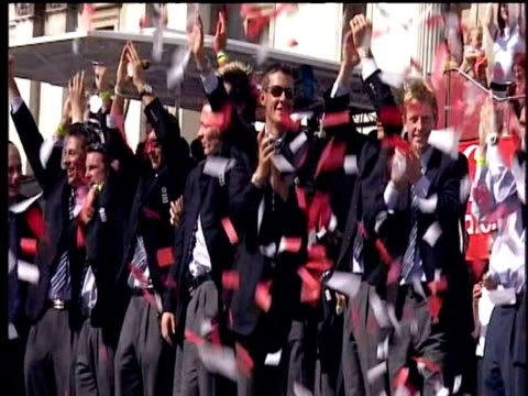 england cricket team wave to crowd in shower of red ticker tape during ashes victory parade trafalgar square; 13 sep 05 - ashes test stock videos & royalty-free footage