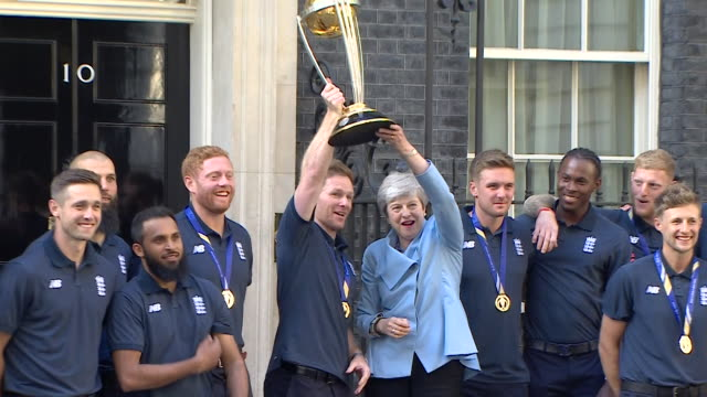 england cricket team world cup winners pose outside downing street with the trophy and theresa may - world sports championship stock videos & royalty-free footage