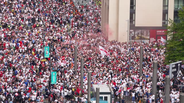 england fan arrive and gather in large crowds at wembley stadium for the 2021 uefa european football championship final match between england and... - italy stock videos & royalty-free footage