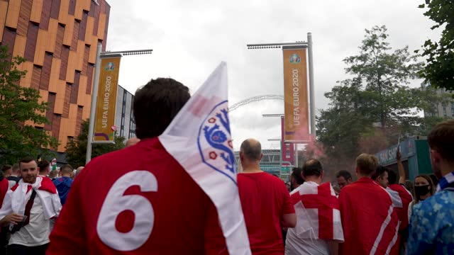 england fan arrive at wembley stadium as a fan wears a bobby moore number 6 england shirt for the 2021 uefa european football championship final... - number 6 stock videos & royalty-free footage