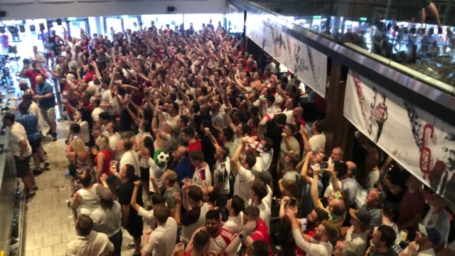 england fans celebrate at as england win 2-0 against sweden as they watch the world cup quarter finals at ashton gate world cup fans village at the... - fußballweltmeisterschaft stock-videos und b-roll-filmmaterial