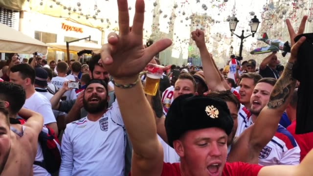 england fans sing songs and soak up the party atmosphere in nikolskaya st near red square ahead of tonight's world cup semifinal game between england... - fifa world cup 2018 stock videos & royalty-free footage