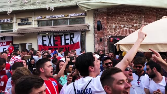 England fans sing songs and soak up the party atmosphere in Nikolskaya St near Red Square ahead of tonight's World Cup semifinal game between England...