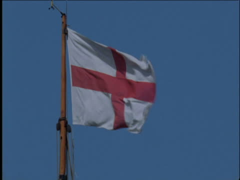 england flag flutters against blue sky liverpool - bandiera inglese video stock e b–roll