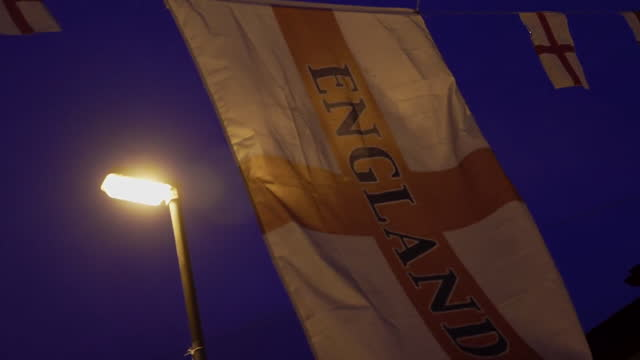 england flag hanging in street in oldham on night of euro 2020 football final, when england lost to italy - symbol stock videos & royalty-free footage