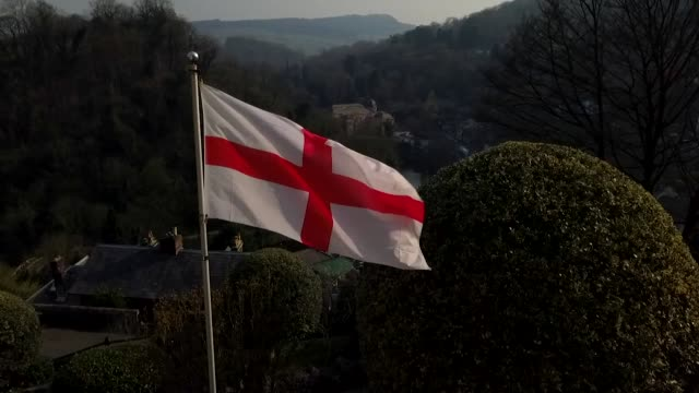 england flag st george's cross flying over derbyshire dales - flag stock videos & royalty-free footage