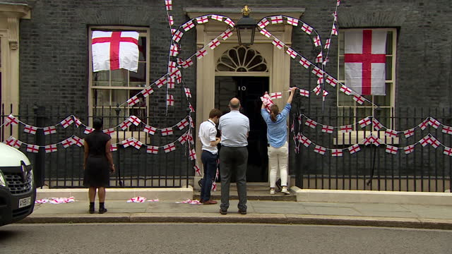 england flags being put up outside 10 downing street to show support for the national team in the euro 2020 final - symbol stock videos & royalty-free footage