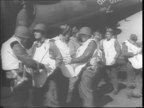 england / flak suits made of heavy bullet proof steel / serviceman handing out new flak suits to airmen from truck on airfield to protect them while... - metal blend stock videos and b-roll footage