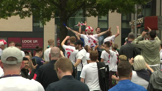 """england football fans arriving at wembley stadium ahead of the semi final match against denmark for euro 2020 - """"bbc news"""" stock videos & royalty-free footage"""