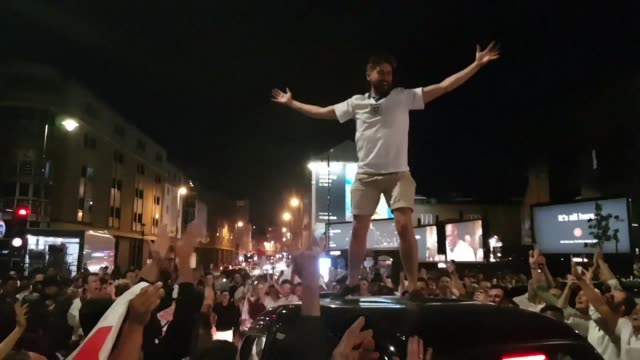 England football fans stop traffic in London on Friday night while celebrating after their team beat Colombia on penalties to reach the World Cup...