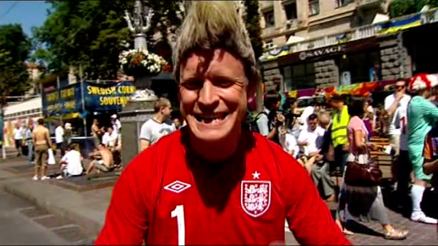 england knocked out by italy on penalties; england fans chanting in street sot supporter kissing the england badge on his shirt man dressed as... - ticket stock videos & royalty-free footage