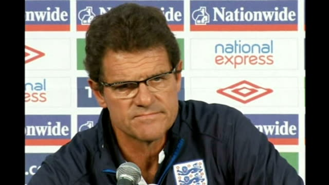 stockvideo's en b-roll-footage met england knocked out: fabio capello press conference; south africa: rustenburg: int fabio capello and adrian bevington arriving at press conference... - english football association