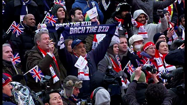 england loses 2018 world cup bid; england: london: ext * * flash photography * * crowd of football fans listening to fifa announcement of 2018 world... - bid stock videos & royalty-free footage