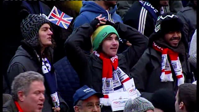 england loses 2018 world cup bid; london: crowd of football supporters backing england world cup 2018 bid groaning in disappointment worker removing... - bid stock videos & royalty-free footage