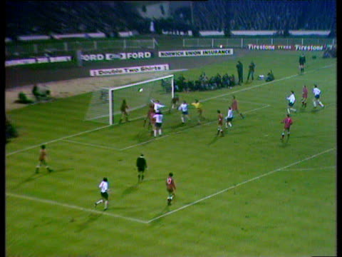 England midfielder Tony Curry takes right foot corner Poland goalkeeper Jan Tomaszewski punches ball against own defender on goal line before being...