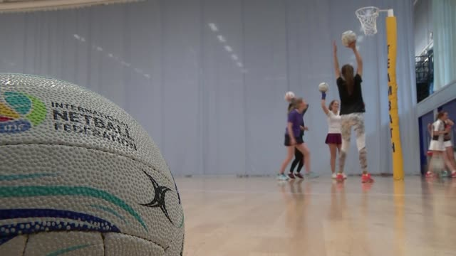 England netball team win gold / highlights of the day ENGLAND INT Ball thrown into net Low angle view netball training session Girl throwing ball...