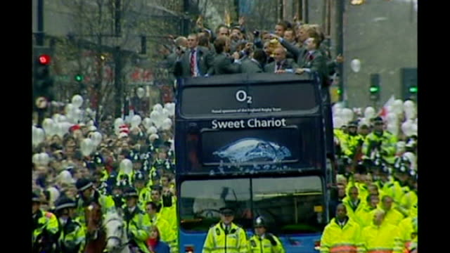 england players wages dispute; tx 8.12.03 england: london: ext open-top bus, named 'sweet chariot' carrying england world cup rugby squad in victory... - parade stock videos & royalty-free footage