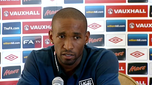 england pre world cup 2014 qualifying campaign press conference; england: hertfordshire: chandler's cross: int jermain defoe arrives / jermain defoe... - whole stock videos & royalty-free footage