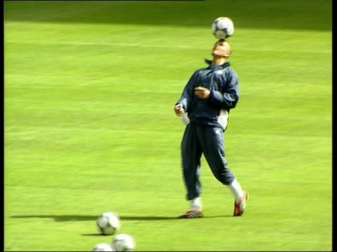 Paris Stade de France England players on pitch during training session England coach Kevin Keegan along on pitch at training session Andy Cole...